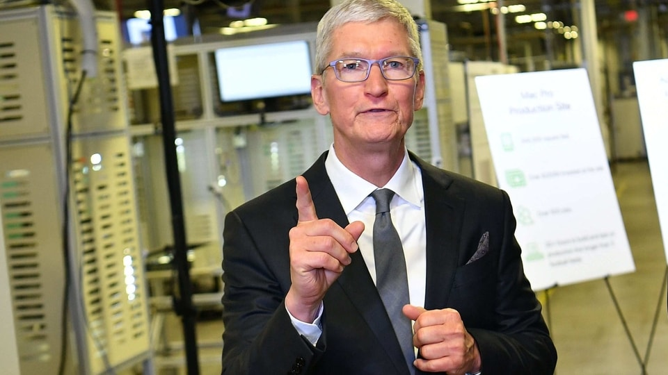 (FILES) In this file photo taken on November 20, 2019 Apple CEO Tim Cook speak to the press during a tour of the Flextronics computer manufacturing facility, with US President Donald Trump, where Apple's Mac Pros are assembled in Austin, Texas. - Apple chief Tim Cook says he wants those involved with the deadly attack on the US Capitol last week to be held accountable, even if that includes US President Donald Trump.