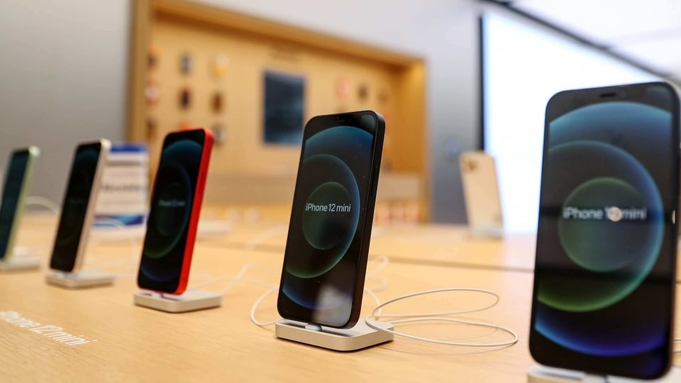 The Apple iPhone 12 Mini at the Apple flagship store during a product launch event in Sydney, Australia, on Friday, Nov. 13, 2020. Sales of the iPhone fell 21% on anticipation of the new models, which arrived later than usual this year. Cook said the response to the 5G iPhone lineup and other new devices has been