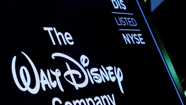 A screen shows the logo and a ticker symbol for The Walt Disney Company on the floor of the New York Stock Exchange (NYSE).