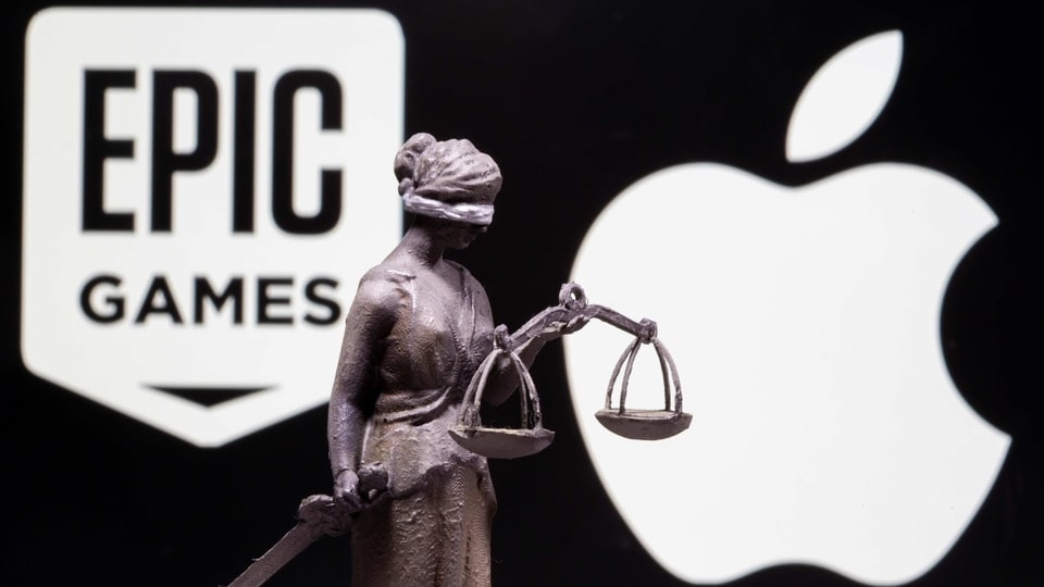 3D printed Lady Justice figure is seen in front of displayed Apple and Epic Games logos in this illustration photo taken February 17, 2021. REUTERS/Dado Ruvic/Illustration