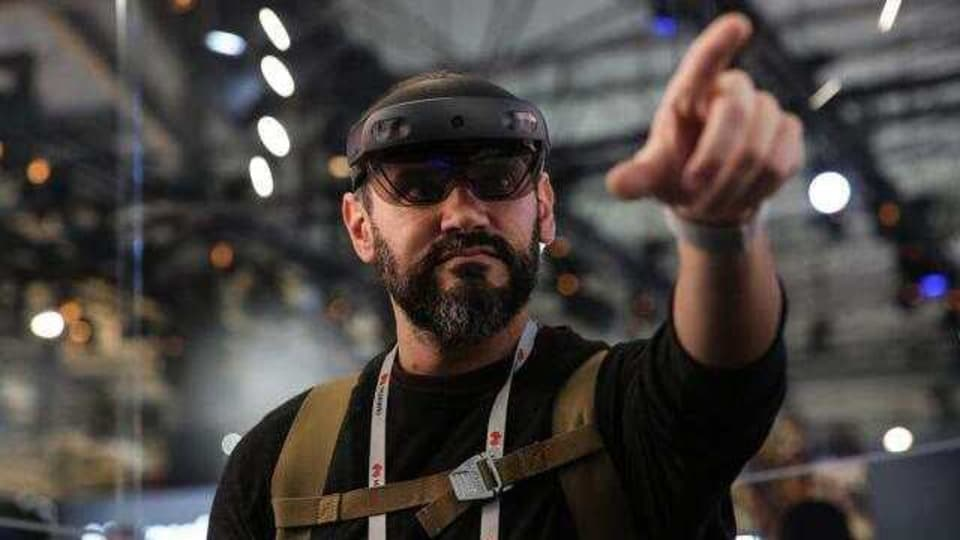 An attendee wears a Microsoft Corp. HoloLens 2 headset as he uses the Bentley Systems Inc. Synchro XR augmented reality (AR) app, at the Microsoft Corp. stand on the opening day of the MWC Barcelona