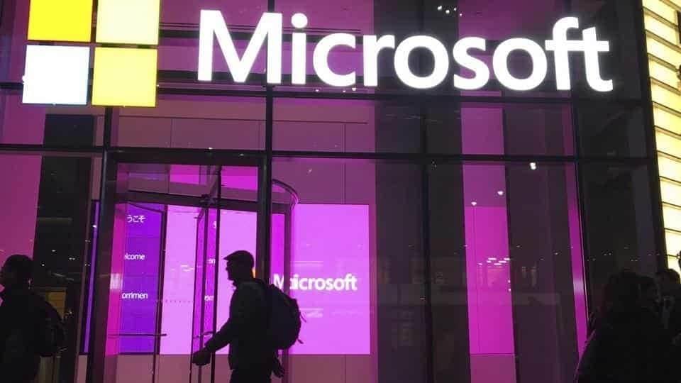 People walk near a Microsoft office in New York.