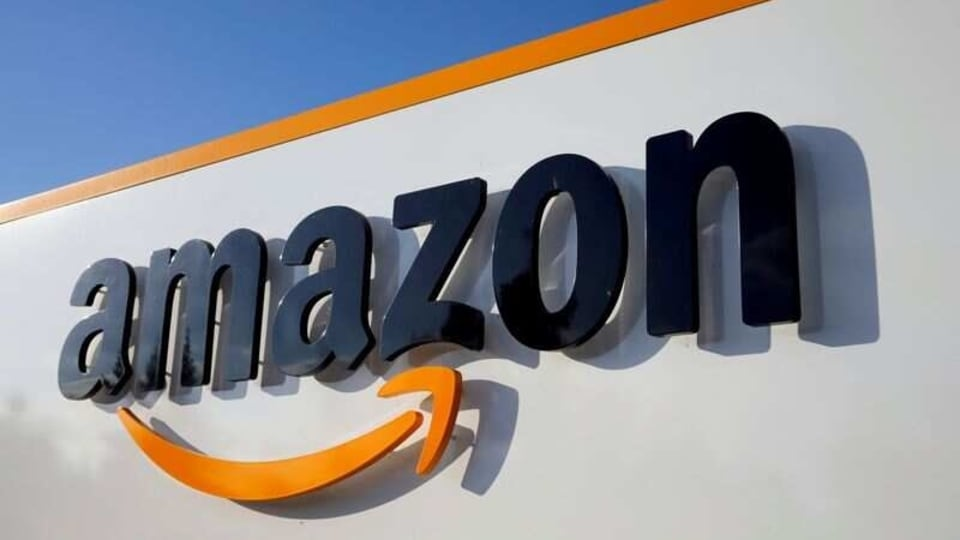 Amid the glare and noise, Amazon workers are struggling to sort fact from fiction—a reflection in part of anation that spentrecent years inhaling the serial fabricationsof former President Donald Trump. REUTERS/Pascal Rossignol/File Photo
