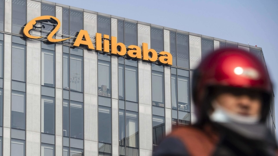 A motorist travels past an Alibaba Group Holding Ltd. office building in Shanghai, China.