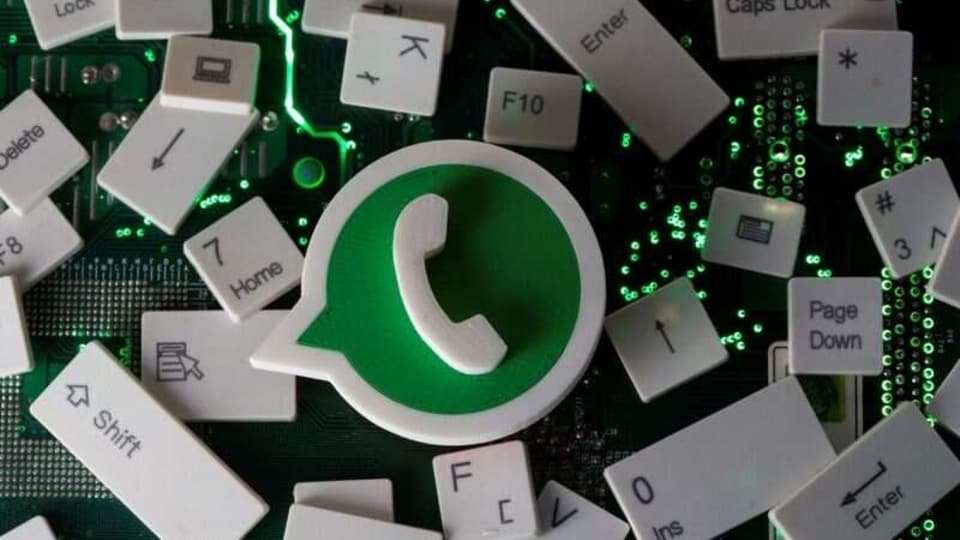 FILE PHOTO: A 3D printed Whatsapp logo and keyboard buttons are placed on a computer motherboard in this illustration taken January 21, 2021. REUTERS/Dado Ruvic/Illustration/File photo