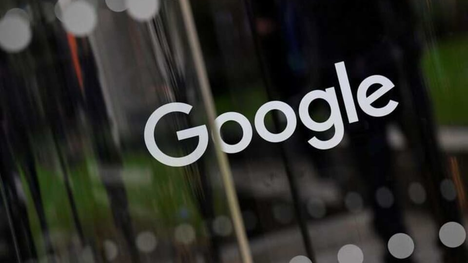 FILE PHOTO: The Google name is displayed outside the company's office in London, Britain, November 1, 2018. REUTERS/Toby Melville/File Photo