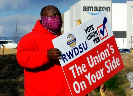 Amazon warehouse workers in Bessemer, overwhelmingly voted against joining the Retail, Wholesale and Department Store Union in much-anticipated election results announced Friday, April 9. (AP Photo/Jay Reeves, File)