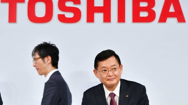 FILE PHOTO: In this November 2018, photo, then Toshiba Corp., Chairman and CEO Nobuaki Kurumatani gets out of a seat after a press conference in Tokyo.