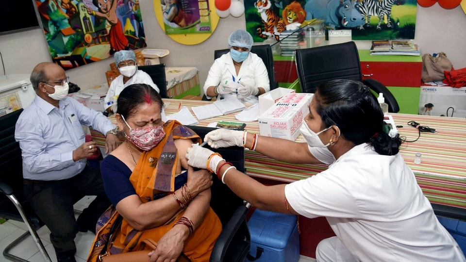 A beneficiary receives the second dose of the Covid-19 vaccine, amid rising coronavirus cases across the country, at a government dispensary in Patna.