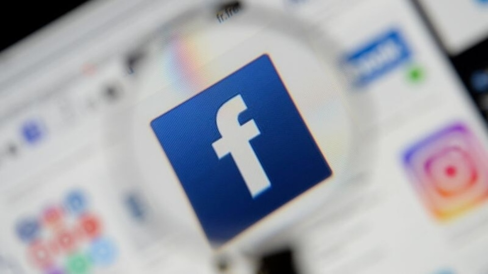 FILE PHOTO: The Facebook logo is seen on a screen in this picture illustration taken December 2, 2019. REUTERS/Johanna Geron/Illustration/File Photo