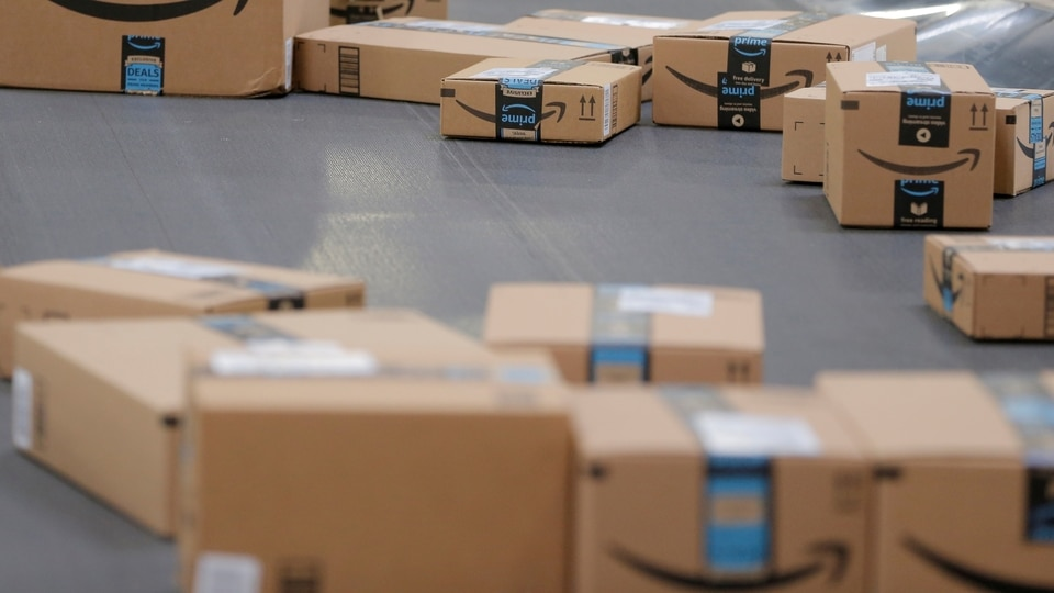 FILE PHOTO: Packages emblazoned with Amazon logos travel along a conveyor belt inside of an Amazon fulfillment center in Robbinsville, New Jersey, U.S., November 27, 2017. REUTERS/Lucas Jackson/File Photo