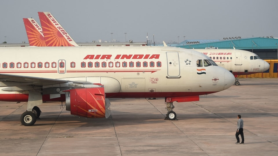 (FILE PHOTO) In this file photo taken on March 2, 2020, an Air India plane is seen parked at the Indira Gandhi International airport in New Delhi. - Hackers have stolen data on about 4.5 million Air India passengers around the world in the latest breach reported by a major airline.