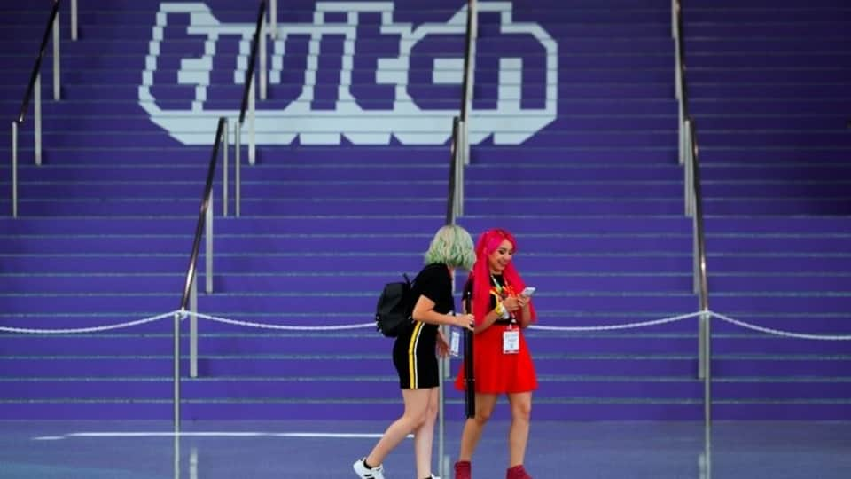 FILE PHOTO: Attendees walk past a Twitch logo painted on stairs during opening day of E3, the annual video games expo revealing the latest in gaming software and hardware in Los Angeles, California, U.S., June 11, 2019. REUTERS/Mike Blake