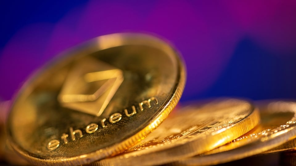 FILE PHOTO: A representation of virtual currency Ethereum are seen in front of a stock graph in this illustration taken February 19, 2021.