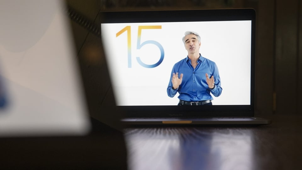 Craig Federighi, senior vice president of software engineering at Apple Inc., speaks virtually during the Apple Worldwide Developers Conference on a laptop computer in Tiskilwa, Illinois, U.S., on Monday, June 7, 2021. Apple is expected to announce its long-rumored 14-inch and 16-inch MacBook Pro with Apple silicon at WWDC, according to Wedbush analyst Daniel Ives. Photographer: Daniel Acker/Bloomberg
