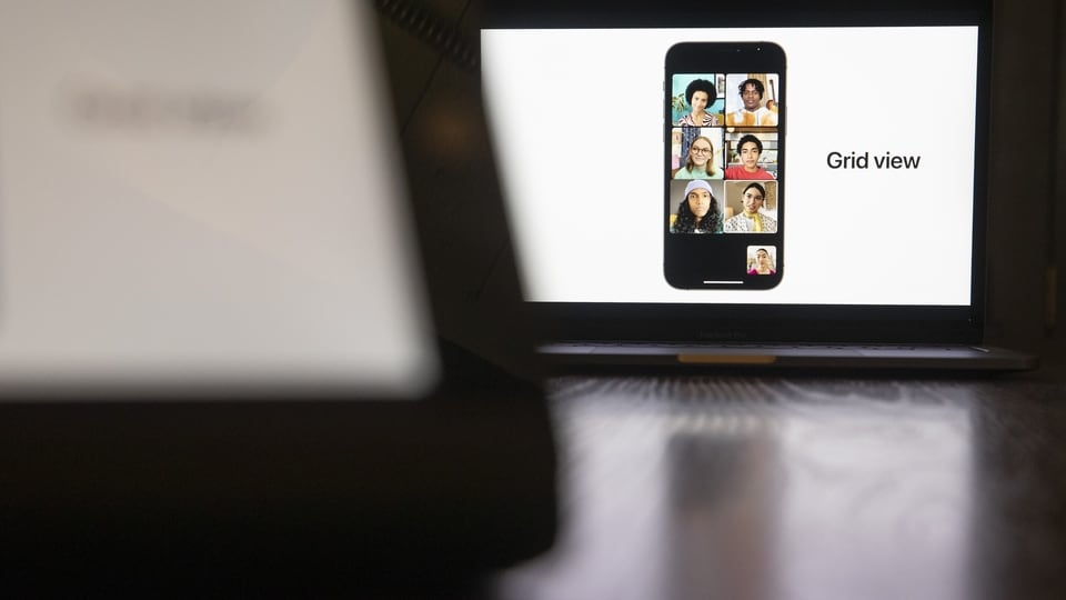 A grid view feature on the FaceTime video chat program on a smartphone presented during the virtual Apple Worldwide Developers Conference on a laptop computer in Tiskilwa, Illinois, U.S., on Monday, June 7, 2021. Apple is expected to announce its long-rumored 14-inch and 16-inch MacBook Pro with Apple silicon at WWDC, according to Wedbush analyst Daniel Ives. Photographer: Daniel Acker/Bloomberg