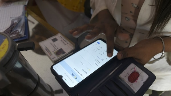 FILE PHOTO: A health worker registering a person on the CoWin app for Covid-19 vaccination, at sector 22 (UPHC) urban primary health centre, in Noida, India, on Thursday, March 25, 2021.
