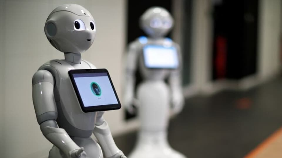 FILE PHOTO: French robot Pepper, detecting whether people are wearing face masks and if not, instructs them to wear them, is displayed at French robotics developer SoftBank Robotics in Paris as the coronavirus disease (COVID-19) continues to spread out across France, September 8, 2020.