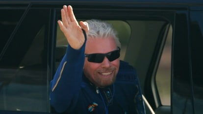 Billionaire entrepreneur Richard Branson departs with his crew prior to boarding, for travel to the edge of space in Virgin Galactic's passenger rocket plane VSS Unity, near Truth or Consequences, New Mexico, U.S., July 11, 2021. REUTERS/Joe Skipper