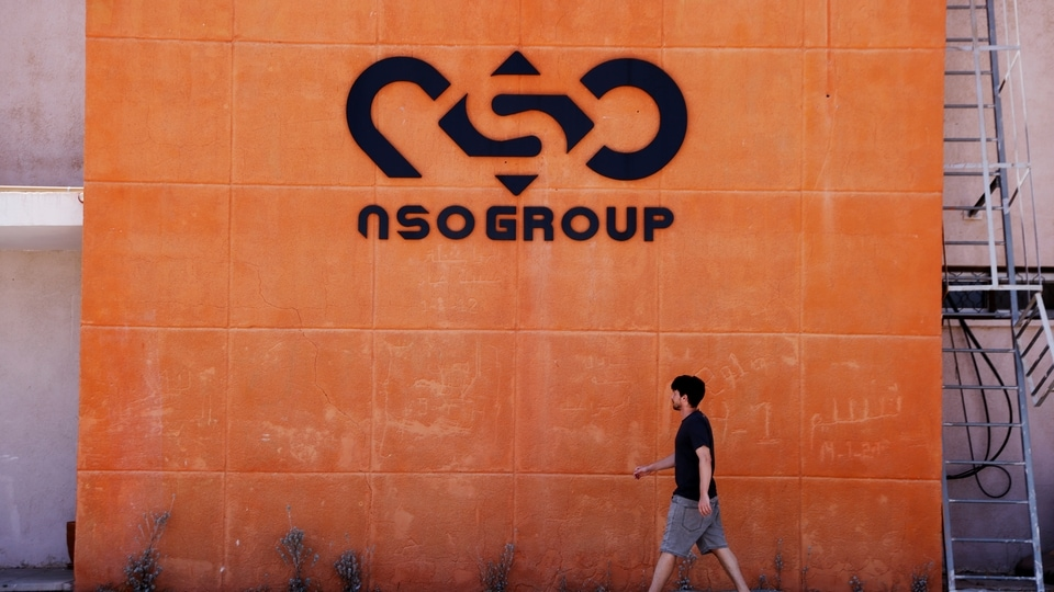 A man walks past the logo of Israeli cyber firm NSO Group at one of its branches in the Arava Desert, southern Israel July 22, 2021.