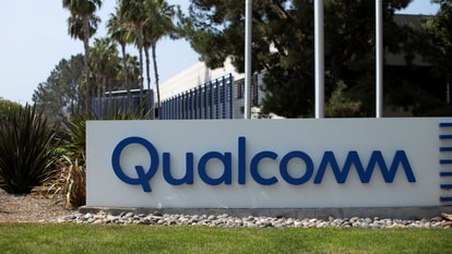 FILE PHOTO: A Qualcomm sign is shown outside one of the company's many buildings in San Diego, California, U.S., September 17, 2020. REUTERS/Mike Blake/File Photo