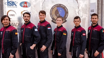 A team of six astronauts from (L to R) Spain, Israel, the Netherlands, Germany, Austria, and Portugal pose for a group photo before starting a training mission for planet Mars at a site that simulates an off-site station at the Ramon Crater in Mitzpe Ramon in Israel's southern Negev desert on October 10, 2021. - Six astronauts from Portugal, Spain, Germany, the Netherlands, Austria, and Israel will be cut off from the world for a month, from October 4-31, only able leave their habitat in spacesuits as if they were on Mars. Their mission, the AMADEE-20 Mars simulation, will be carried out in a Martian terrestrial analog and directed by a dedicated Mission Support Center in Austria, to conduct experiments ahead of future human and robotic Mars exploration missions. (Photo by JACK GUEZ / AFP)