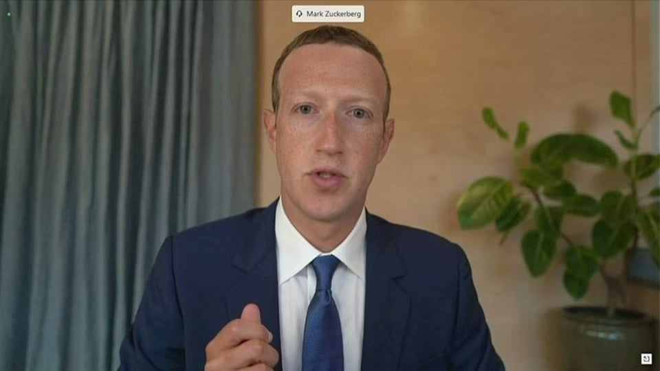 FILE PHOTO: Facebook CEO Mark Zuckerberg testifies remotely via videoconference in this screengrab made from video during a Senate Judiciary Committee hearing titled,