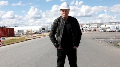 FILE PHOTO: SpaceX founder and Tesla CEO Elon Musk looks on as he visits the construction site of Tesla's gigafactory in Gruenheide, near Berlin, Germany, May 17, 2021.