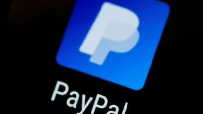 FILE PHOTO: The PayPal app logo is seen on a mobile phone in this illustration photo, Oct. 16, 2017. REUTERS/Thomas White/File Photo