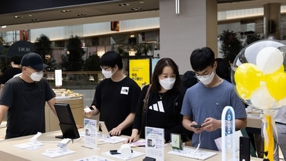 Customers try out Samsung Electronics Co. Galaxy Z Fold 3 and Galaxy Z Flip 3 smartphones at the company's Digital Plaza store inside the Hyundai Seoul department store in Seoul, South Korea.
