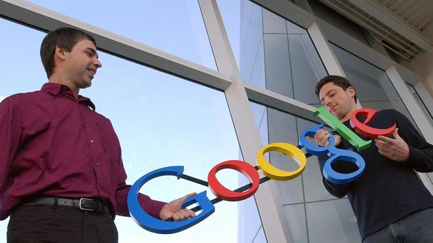 In this Jan. 15, 2004, file photo Google co-founders Larry Page, left, and Sergey Brin pose for a photo at their company's headquarters in Mountain View, California.