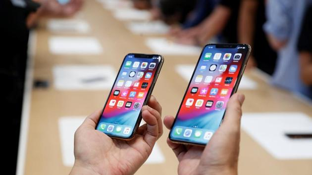 FILE PHOTO: A man holds the newly released Apple iPhone XS and XS Max during a product demonstration following the Apple launch event at the Steve Jobs Theater in Cupertino, California, U.S., September 12, 2018.