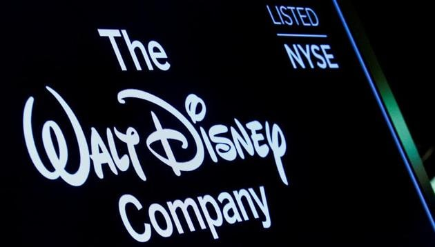 FILE PHOTO: A screen shows the logo and a ticker symbol for The Walt Disney Company on the floor of the New York Stock Exchange (NYSE) in New York, U.S., December 14, 2017.