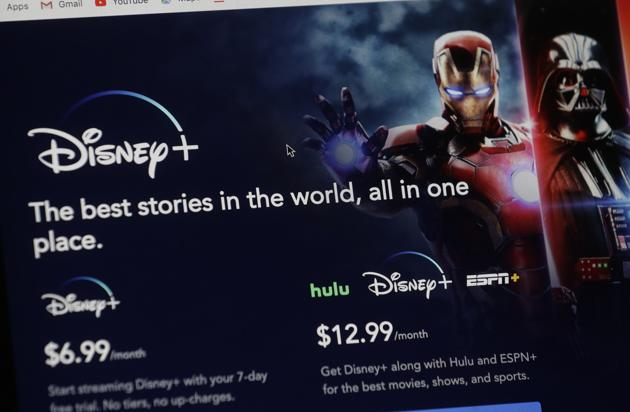 An introductory page on the Disney Plus website is displayed on a computer screen in Walpole, Mass., Wednesday, Nov. 13, 2019. Disney Plus says it hit more than 10 million sign-ups on its first day of launch, far exceeding expectations.