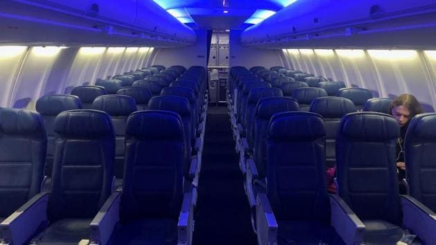 An air traveler sits among empty seats on a Delta flight to San Francisco, after further cases of coronavirus were confirmed in New York, at JFK International Airport, New York (representative image)