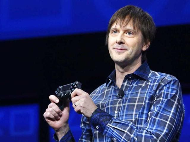 PlayStation 4's lead system architect Mark Cerny holds a gaming control device during the unveiling of the PlayStation 4 launch event in New York. Reuters/Brendan McDermid