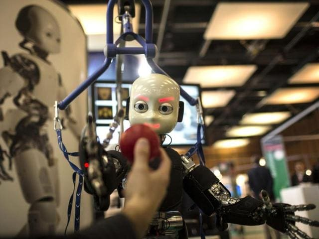 The iCub robot tries to catch a ball during the Innorobo 2013 fair, an event dedicated to the service robotics industry, in Lyon. AP photo