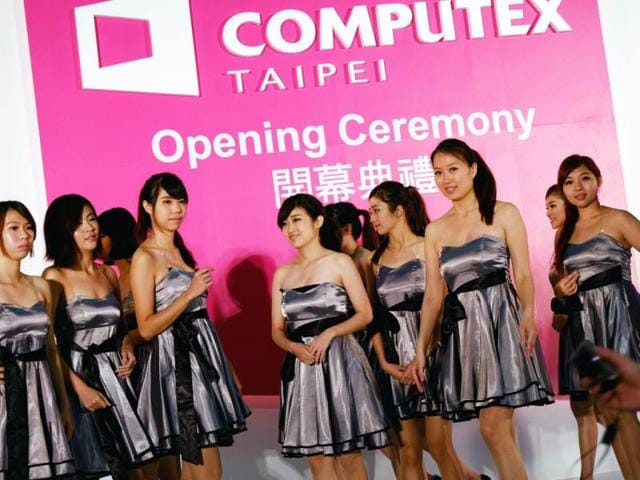 Volunteer workers pose for photo during the Computex tech show in Taipei. Photo: AFP / Sam Yeh