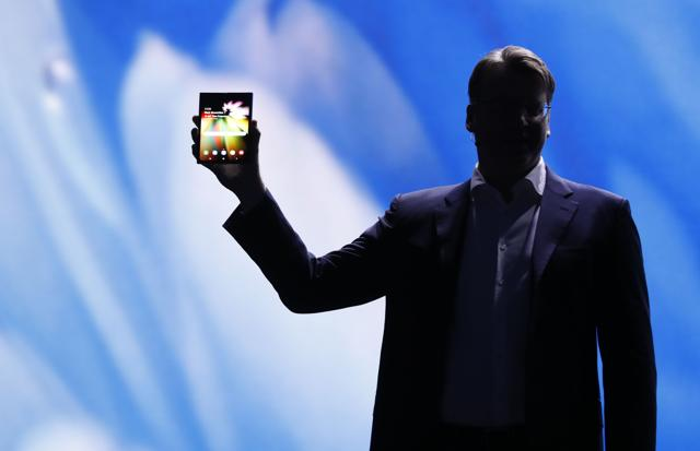 Justin Denison, Samsung Electronics senior vice president of Mobile Product Marketing, speaks during the unveiling of Samsung's new foldable screen smart phone.