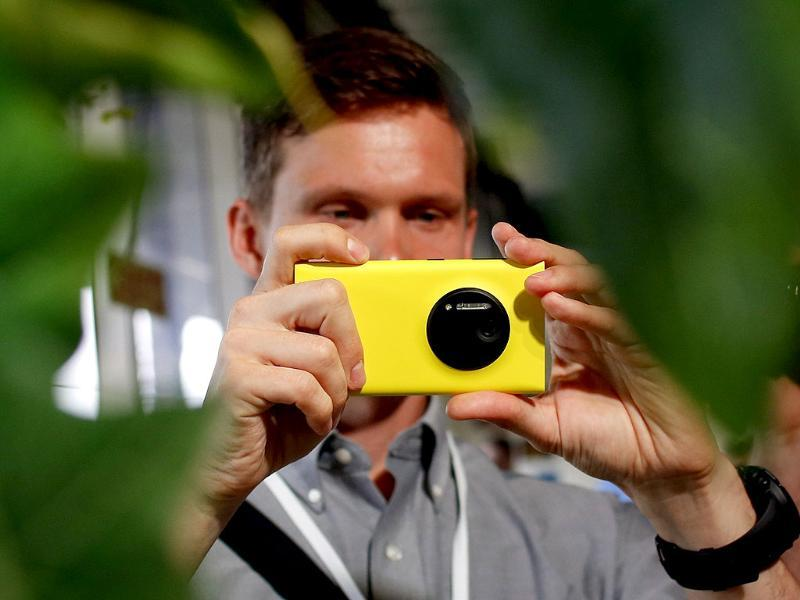 A man takes pictures with Nokia's new smartphone, the Lumia 1020 with a 41-megapixel camera, after its unveiling in New York. Photo: Reuters/Shannon Stapleton