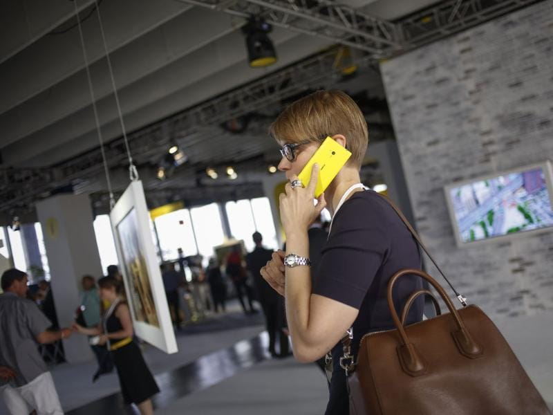 A woman uses Nokia's new smartphone, the Lumia 1020 with a 41-megapixel camera, after its unveiling in New York. Photo: Reuters/Shannon Stapleton