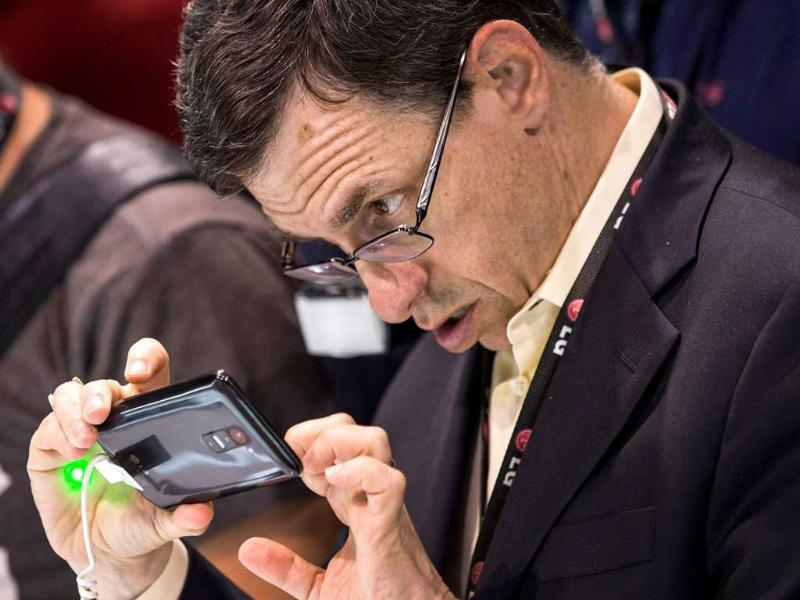 A man looks at the LG G2 smartphone at the phone's launch event in New York City. Photo: Andrew Burton/Getty Images/AFP