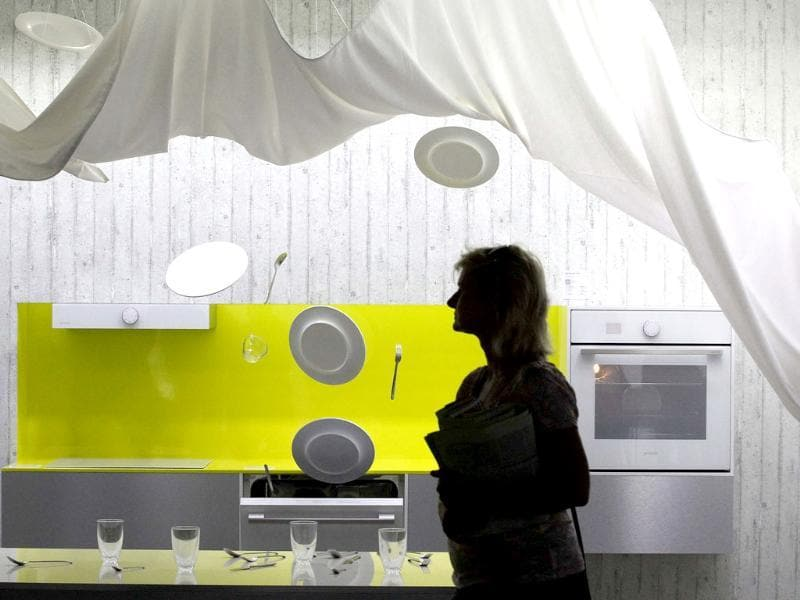 A visitor passes a dishwasher installation during the opening day of the IFA consumer electronics fair in Berlin. Photo: Reuters/Tobias Schwarz