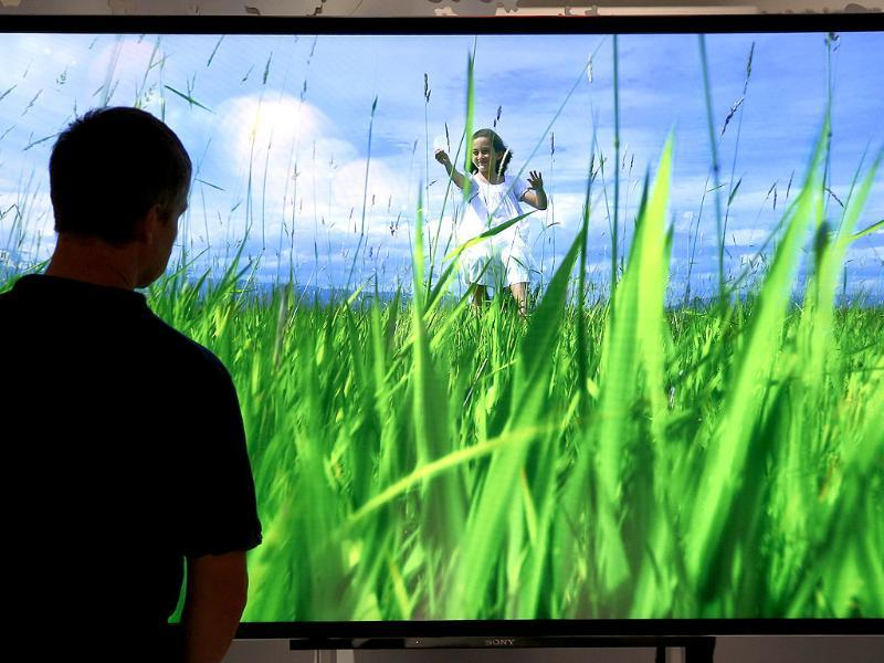 A visitor looks at a giant Sony flat screen at the IFA, one of the world's largest trade fairs for consumer electronics and electrical home appliances in Berlin, Germany. Photo: AP/Michael Sohn