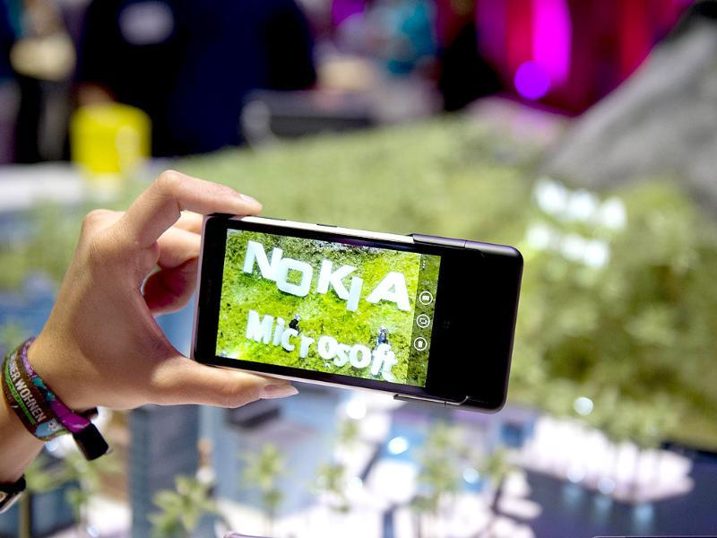 The logo of Finnish mobile manufacturer 'Nokia' and US multinational software company 'Microsoft' are seen on the display of the Lumia 1020 Windows smart phone at the booth of German telecommunications company 'Deutsche Telekom' at the 53rd IFA electronics trade fair in Berlin. Photo: AFP / Odd Andersen
