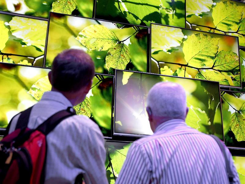 Visitors look at Panasonic Ultra HD TV screens at the IFA, one of the world's largest trade fairs for consumer electronics and electrical home appliances in Berlin, Germany Photo: AP/Michael Sohn