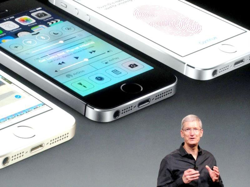 Apple chief executive Tim Cook praises the new iPhone 5S calling it the most refined model the company has ever introduced. (AFP Photo)
