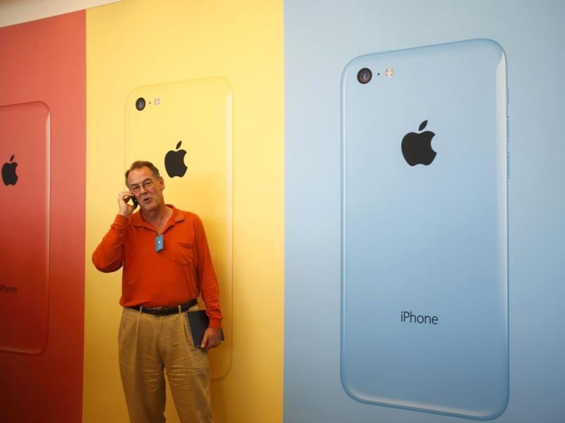 A man talks on his phone after Apple Inc's media event in Cupertino, California. (Reuters Photo)