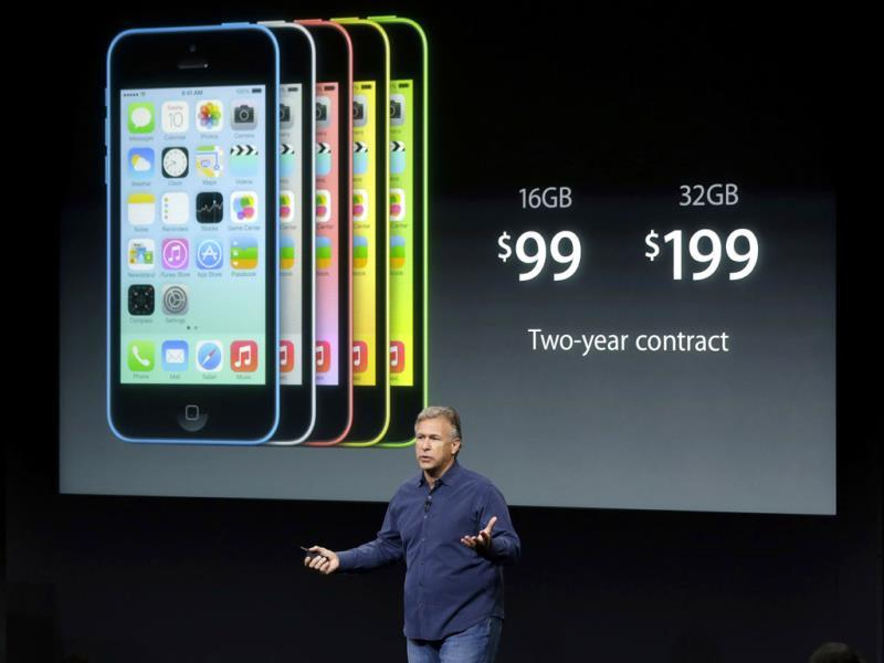 Phil Schiller, Apple's senior vice president of worldwide product marketing, speaks on stage during the introduction of the new iPhone 5c. (AP Photo)