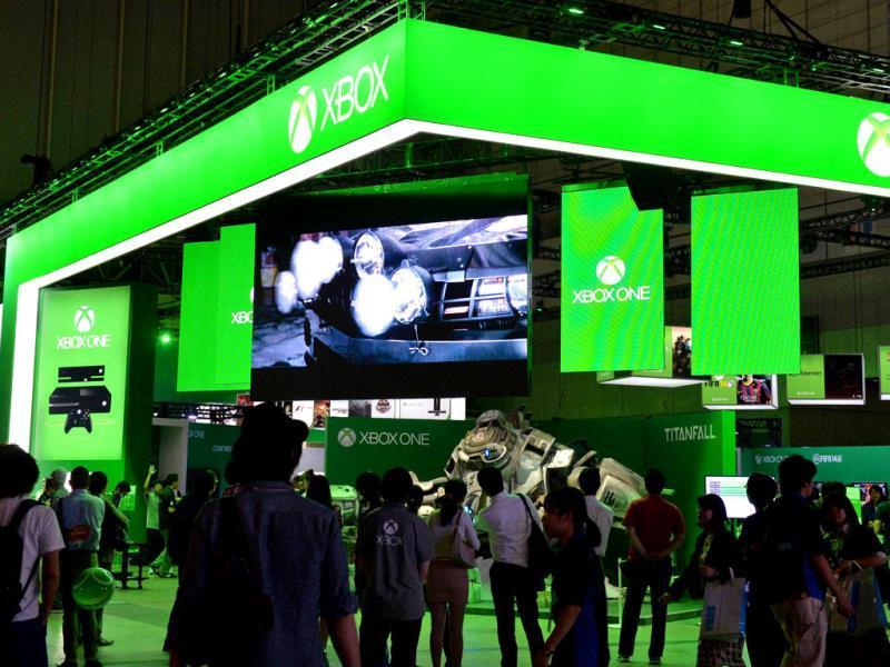 Visitors walk past US software giant Microsoft's Xbox One stall at the Tokyo Game Show in Chiba, suburban Tokyo. Photo: AFP / Yoshikazu Tsuno